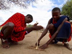 Massai making fire